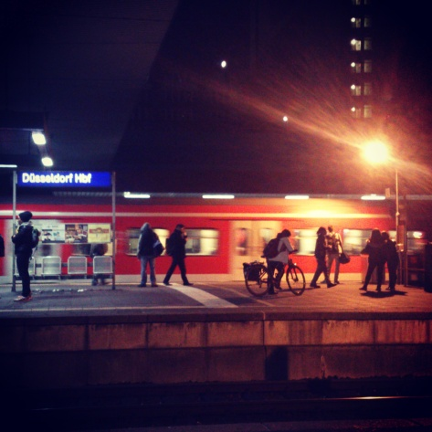8pm at Düsseldorf Hauptbahnhof / Main Train Station in Germany. Platform 13 & 14 seen from Platform 12.  Photo: Cornelia Kaufmann