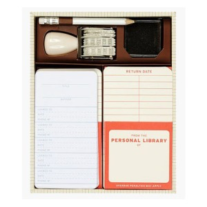 Personal Library Kit with stamp, stamp pad, pencil, pockets and check-out cards. Photo: The Literary Gift Company