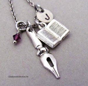 Fountain pen nib, book, birthstone and initial charm necklace. Photo: Etsy
