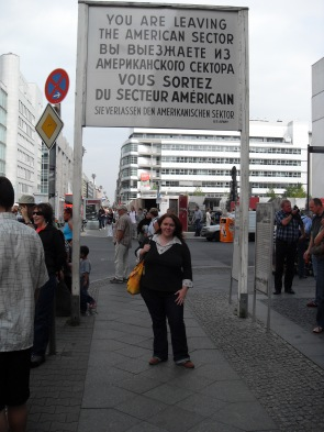 Me, standing underneath the sign at checkpoint Charlie saying we are now leaving the American/Allied sector of Berlin. Photo: Cornelia Kaufmann
