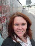 1.5km of the Berlin Wall remain standing as a reminder of what once was. This is me at East Side Gallery, Berlin. Photo: Cornelia Kaufmann