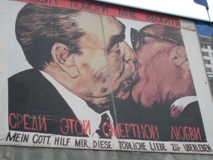"""Bruderkuss, Fraternal Kiss mural of Erich Honecker and Leonid Brezhnev by USSR artist Dmitri Vrubel entitled """"My God, Help Me To Survive This Deadly Love"""" 1990, East Side Gallery. Photo by Cornelia Kaufmann"""