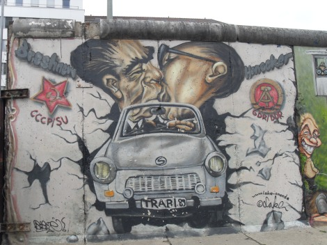 Bruderkuss, Fraternal Kiss mural of Erich Honecker and Leonid Brezhnev kissing while driving a Trabant. East Side Gallery. Photo by Cornelia Kaufmann