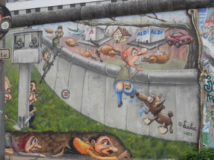 Mural on a piece of the Berlin Wall at East Side Gallery, Berlin, that shows various attempts of fleeing the German Democratic Republic. Photo: Cornelia Kaufmann