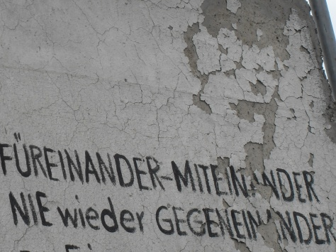 For Each Other - Together. Never Again Against Each Other. Graffiti at East Side Gallery, Berlin. Photo: Cornelia Kaufmann