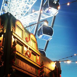 Christmas Market huts and Ferris Wheel, Altstadt Düsseldorf. Photo by Cornelia Kaufmann