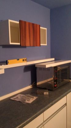 Kitchen painted and shelves ready to go on the wall