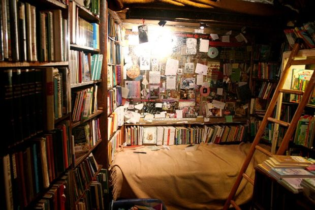 Bed and notice board on the third floor of Shakespeare & Co. bookstore in Paris. Photo by Glynnis Ritchie/flickr