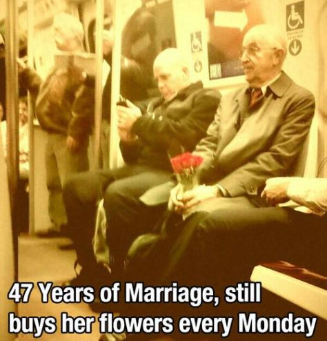 Man with flowers on the Underground