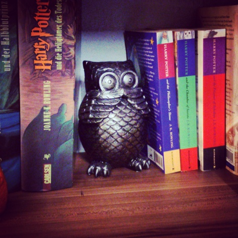 My German Harry Potter books (left) and English Harry Potter books (right), separated by Hedwig. Photography by Cornelia Kaufmann