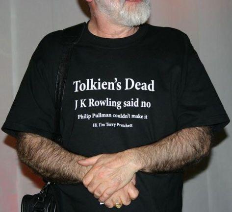 "Terry Pratchett wearing his ""Tolkien's Dead, J.K. Rowling said no, Philip Pulllman couldn't make it. Hi I'm Terry Pratchett"" Tshirt."