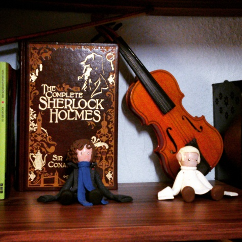 My leather-bound Complete Sherlock Holmes, with a small violin and bow as well as figurines of Sherlock and John as they appear on the BBC show Sherlock. Photography by Cornelia Kaufmann
