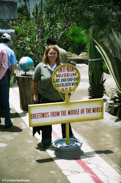 Me standing on both hemispheres at once, at Intiñan, Mitad del Mundo, Ecuador. Copyright Cornelia Kaufmann