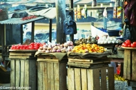 Colourful market vendor in Cape Coast. Copyright Cornelia Kaufmann