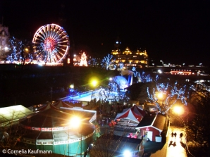 Edinburgh Christmas Market in Princes Street Gardens, view from The Mound towards the Balmoral Hotel. Copyright Cornelia Kaufmann
