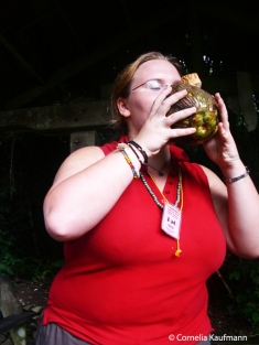 Drinking straight from a recently harvested coconut. Copyright Cornelia Kaufmann