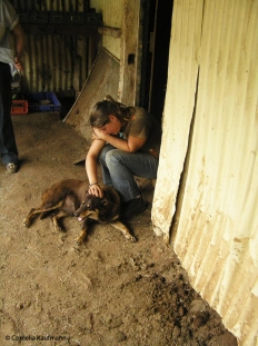 Kat takes a break with Leconfield's Aussie shepherd. Copyright Cornelia Kaufmann