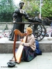 Harp player by the Molly Malone statue. Copyright Cornelia Kaufmann