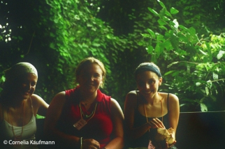 Enjoying a coconut with friends to celebrate a successful hike. Copyright Cornelia Kaufmann
