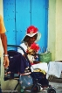 Matching hats - Lady with dog in Habana Vieja. Copyright Cornelia Kaufmann