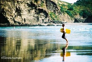 Surfer at Piha Beach. Copyright Cornelia Kaufmann
