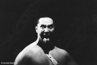 A warrior challenges visitors during the kapa haka by sticking his tongue out and making his eyes wide. Copyright Cornelia Kaufmann