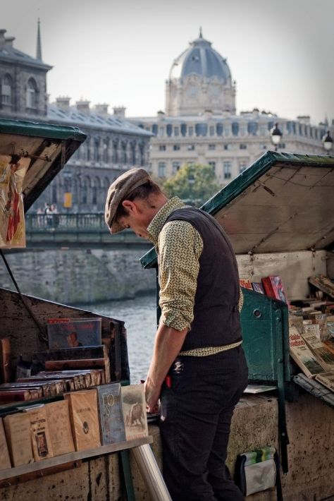 Vintage bookseller along the Seine in Paris. Photographer unknown