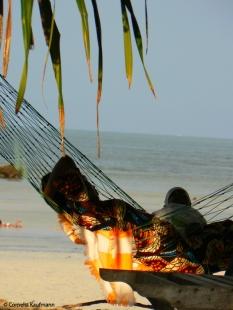 Relaxing in hammocks on the beach in Jambiani. Copyright Cornelia Kaufmann