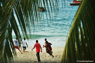 Ball game on the beach. Copyright Cornelia Kaufmann