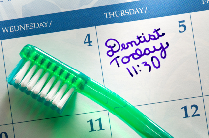 Tooth brush on calendar with Dental Appointment reminder.