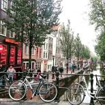 Bikes leaning against a bridge over a canal in Amsterdam's Red Light District De Wallen. © Cornelia Kaufmann