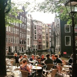 Morning coffee sitting along a gracht in Amsterdam. © Cornelia Kaufmann.