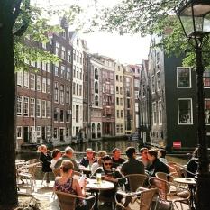 Morning coffee sitting along a gracht in Amsterdam. © Cornelia Kaufmann.