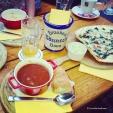 Savoury dinner at Brauhaus Bönnsch in Bonn, consisting of goulash soup, leek cream soup, Flammkuchen, homemade beer bread, lard, and several glasses of Bönnsch beer brewed on the premises. © Cornelia Kaufmann