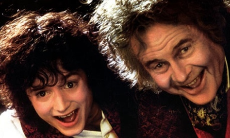 Frodo (Elijah Wood) and older Bilbo Baggins (Ian Holm) at the birthday party in Lord of the Rings: The Fellowship of the Ring.