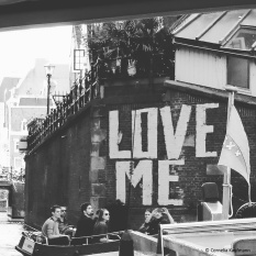 Love Me graffiti along the side of a canal in Amsterdam. © Cornelia Kaufmann
