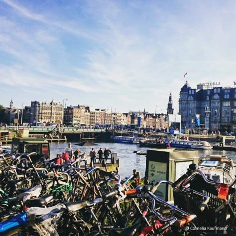 Amsterdam's Damrak and bikes seen from Amsterdam Centraal Station @Cornelia Kaufmann