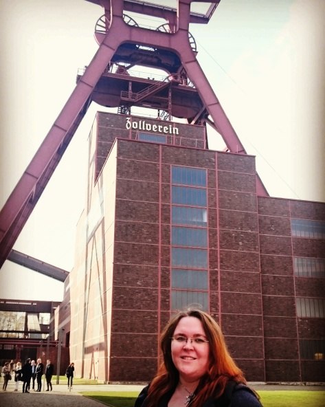 In front of the main tower over Shaft XII at Zeche Zollverein Coal Mining Complex in Essen. Zeche Zollverein is a UNESCO World Heritage Site. ©Cornelia Kaufmann